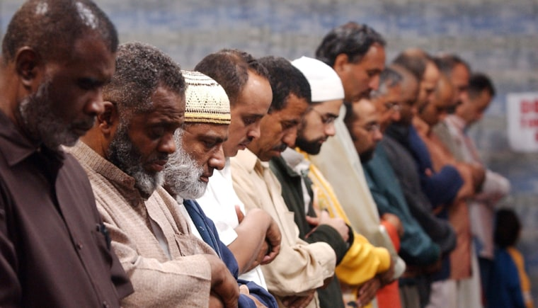 Worshippers pray during Ramadan services at the Islamic Center of Hawthorn on Sunday in Hawthorn, Calif., where the imam urged prayer for victims of the Pakistani earthquake.