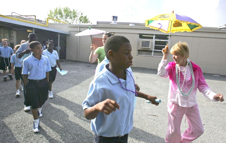 Teacher's assistants lead fourth and fifth graders to class on first day of school since Hurricane Katrina hit in Louisiana