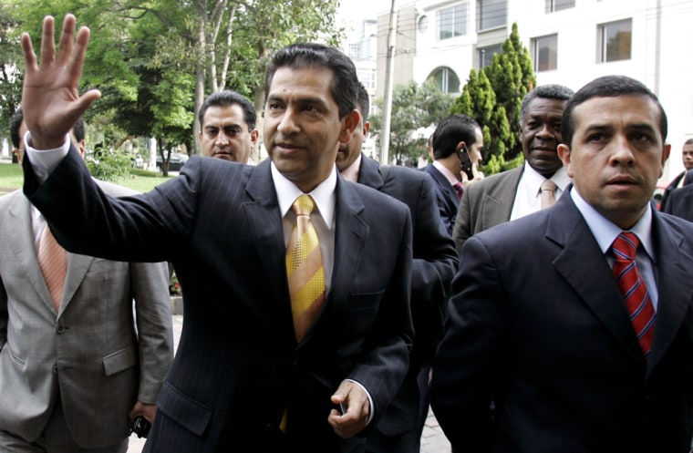 Former Ecuadorean President Lucio Gutierrez waves Thursday as he arrives to make a formal announcement of his plans at a news conference in Bogota, Colombia.