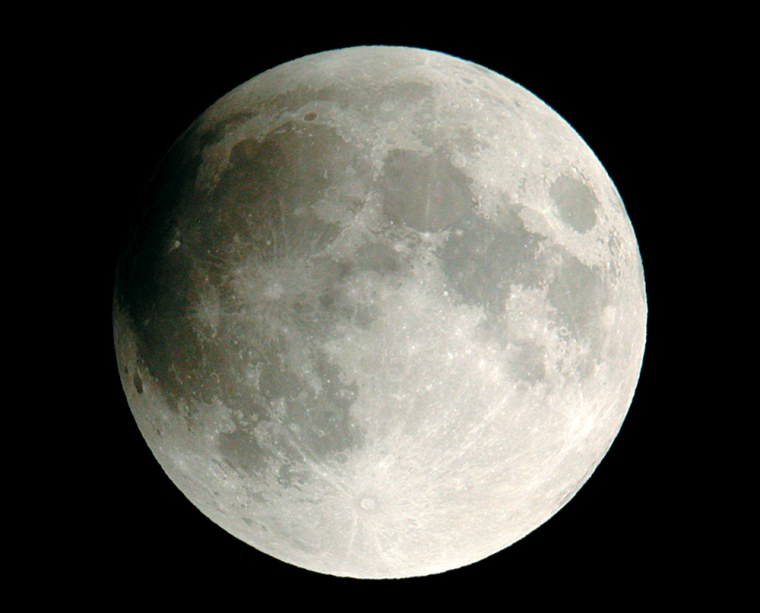 The moon looks here about as it will at the middle of its weak little eclipse on Monday. Although the umbra covers only a bit of the moon's edge, the pale penumbra washes over a wider area. Sky & Telescope associate editor Gary Seronik shot this photo during the eclipse of Nov. 8, 2003.