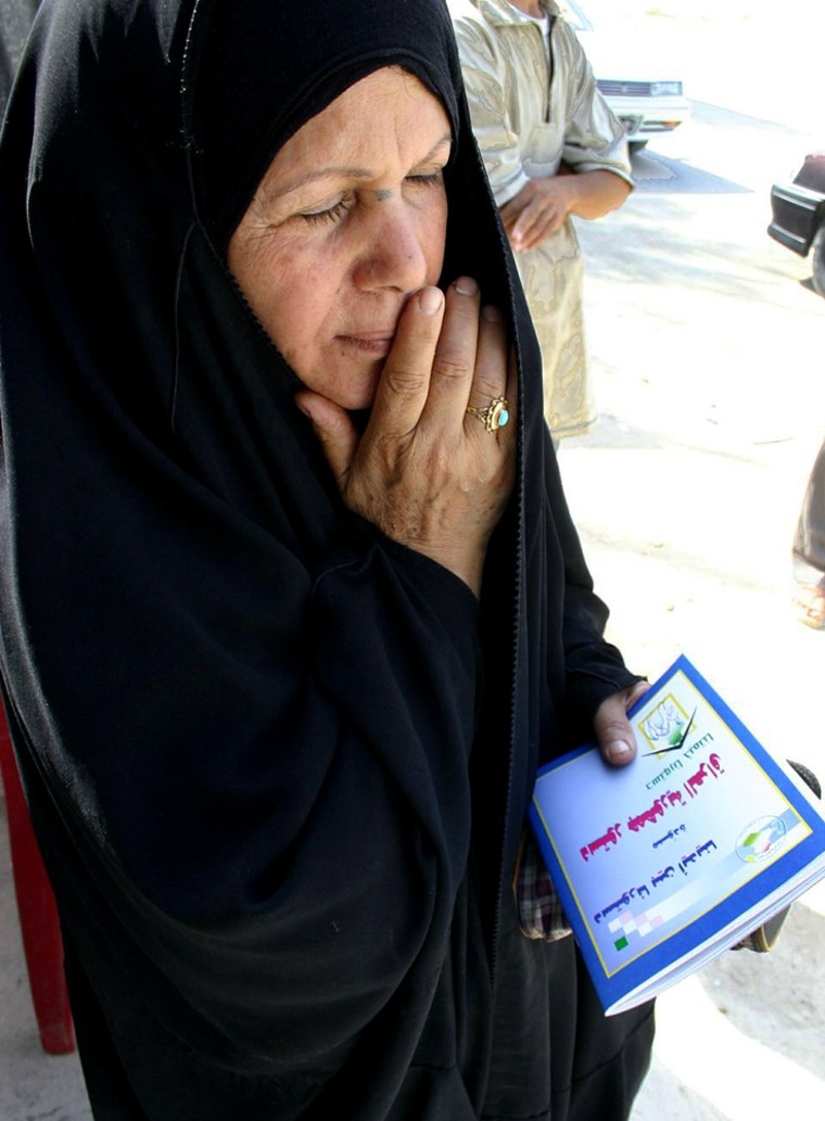 An Iraqi woman holds a copy of the draft