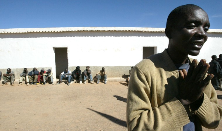 Cameroonian Jack Dikama speaks to the pr