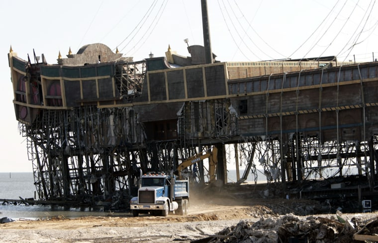 A truck hauls away debris from what remains of the Treasure Bay Casino in Biloxi, Miss., on Oct. 8.