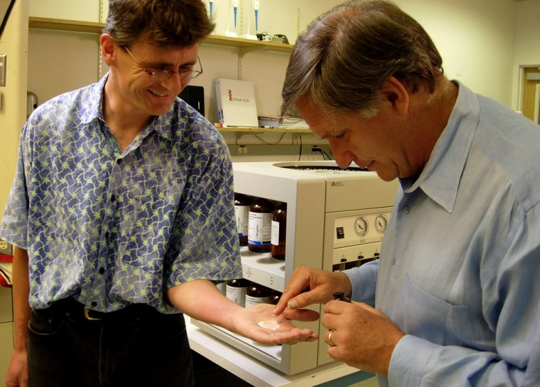 """Jeremy Minshull, president of a company called DNA 2.0, shows """"Nova ScienceNOW"""" host Robert Krulwich a handful of dust that contains thymine, the """"T"""" of A, T, G, C, one of thefour bases that provide the building blocks of DNA."""