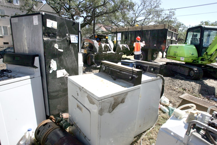 Home appliances damaged by Hurricane Katrina sit in front of homes in New Orleans on Tuesday. Residents are placing damaged items along the streets for pickup.
