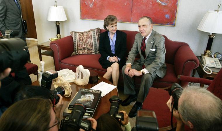 Sen. Arlen Specter, R-Pa., meets Supreme Court nominee Harriet Miers in his office onMonday.
