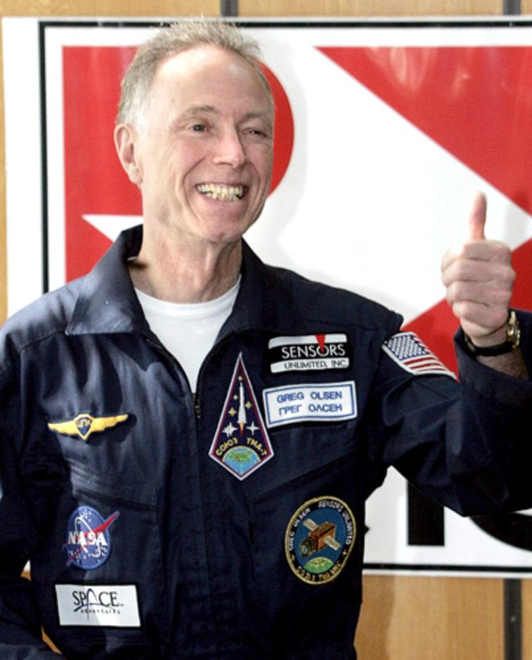 US space tourist Greg Olsen gestures dur