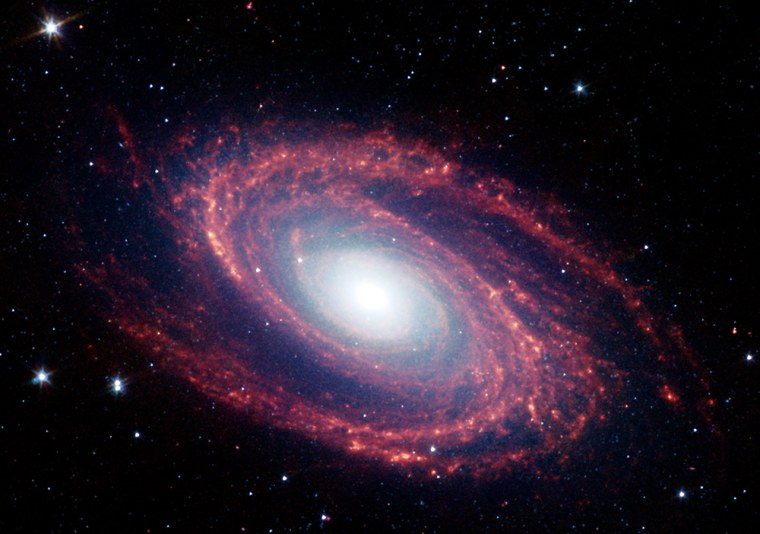 NASA's Spitzer Space Telescope captured thisimage of the spiral galaxy M81, located 12 million light years from Earth. The infrared radiation emitted bynitrogen-containing polycyclic aromatic hydrocarbonmolecules is shown in red.