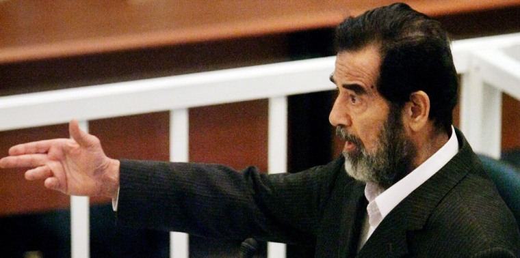 Saddam Hussein addresses judges at his trial in Baghdad's heavily fortified Green Zone
