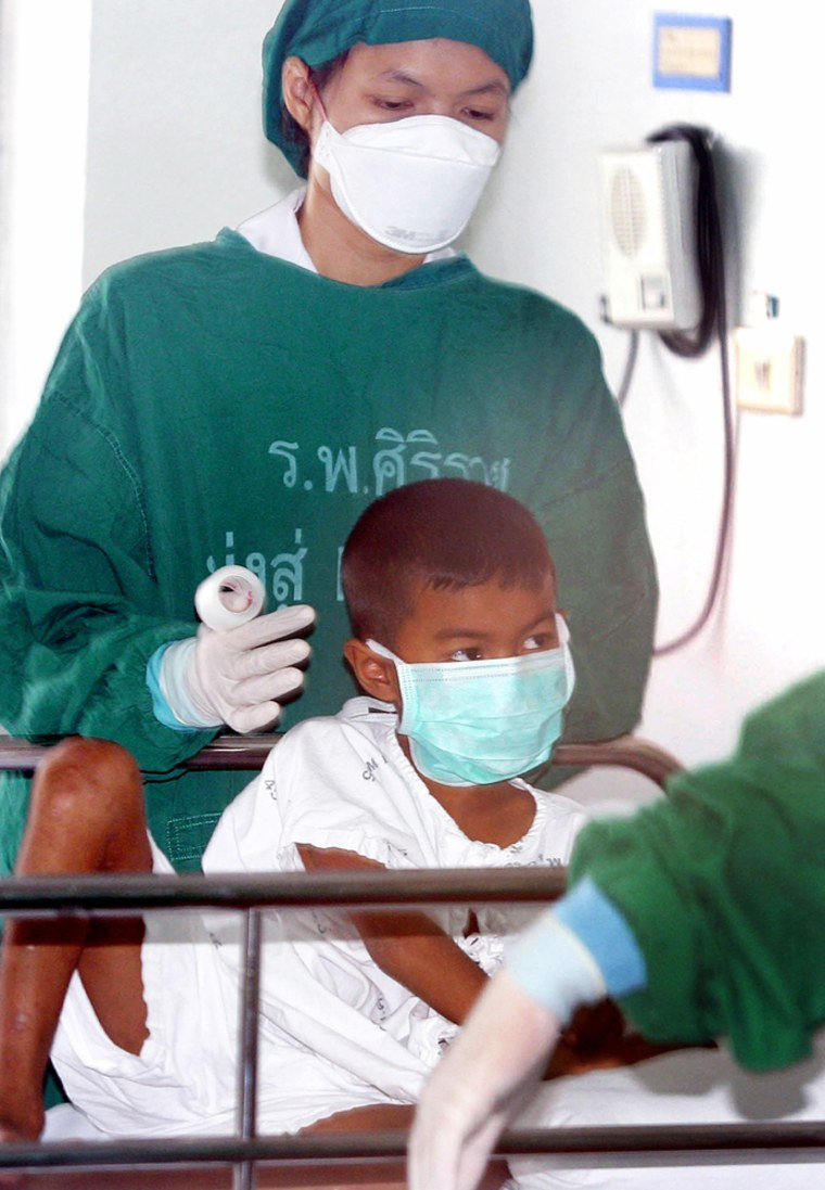Seven-year-old Thai boy rests in Bangkok hospital, one day after lab tests confirmed his 48-year-old father as Thailand's 13th victim of deadly bird flu virus