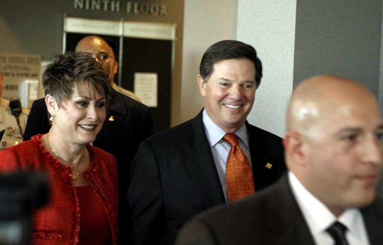 Rep. Tom DeLay enters an Austin courtroom with his wife, Christine, Friday in his first court appearance on money laundering and conspiracy charges.