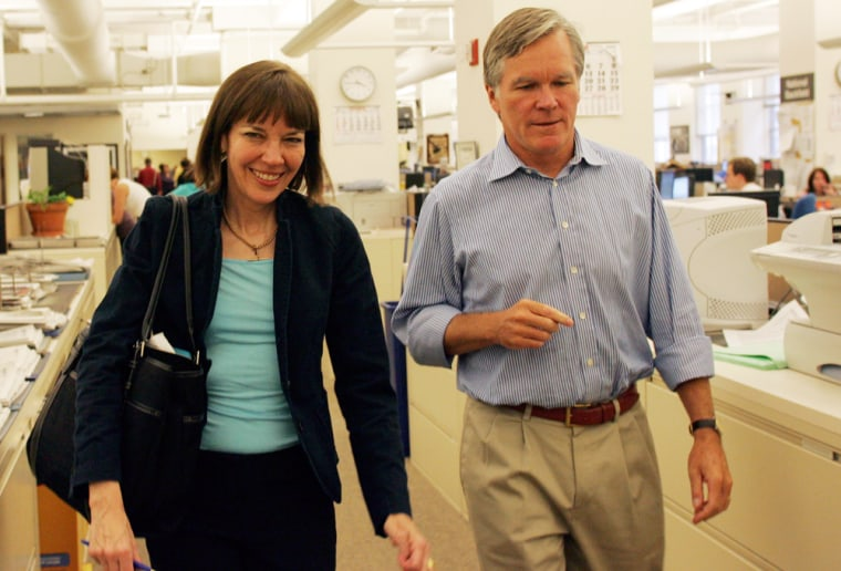 This photo provided by The New York Times shows New York Times reporter Judith Miller, left, walking withExecutive Editor Bill Keller after being welcomed back to the newsroom by staff and editorsOct. 3 at the New York Times offices in New York.