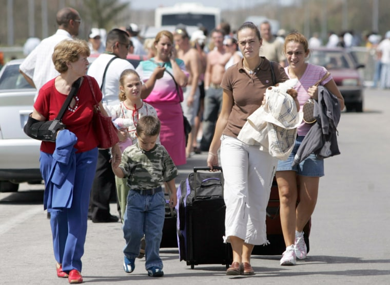 Foreign tourists arrive at Cancun 's international air port as they prepare to fly out of the Mexican Caribbean resort