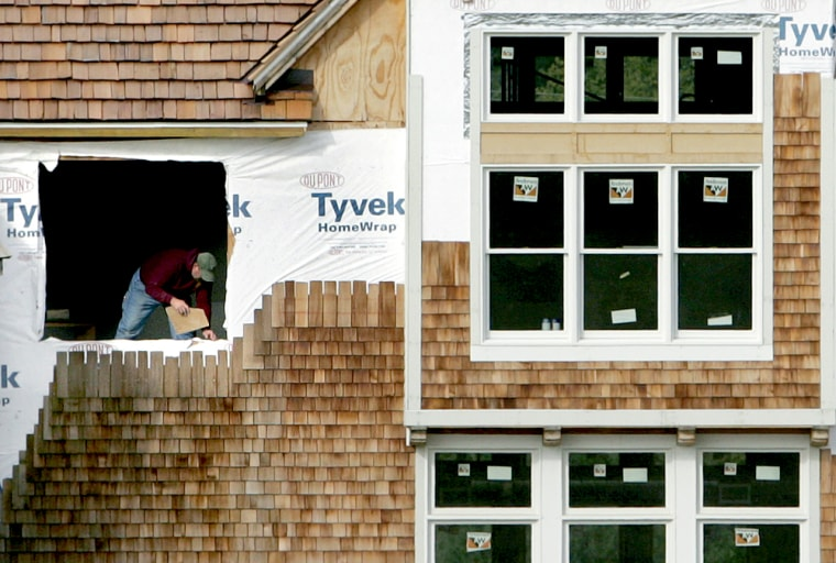 A worker sets a window sill on a new home under construction in South Russell, Ohio last month. On Thursday, the government reported sales of new U.S. homes rose more slowly than expected in September.