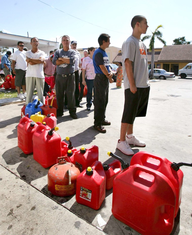 Miami residents wait in long gas lines in Little Habana after Hurricane Wilma hit Florida's east coast