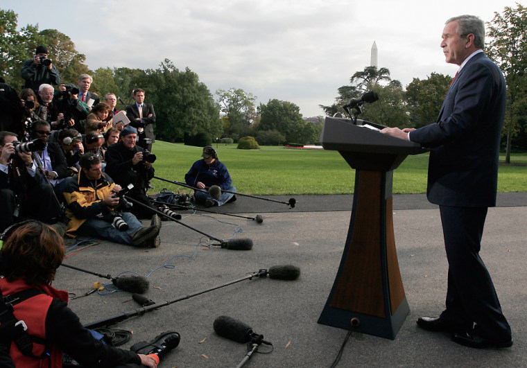 """President Bush address reporters at the White House on Friday after senior aide Lewis """"Scooter"""" Libby was indicted and resigned."""