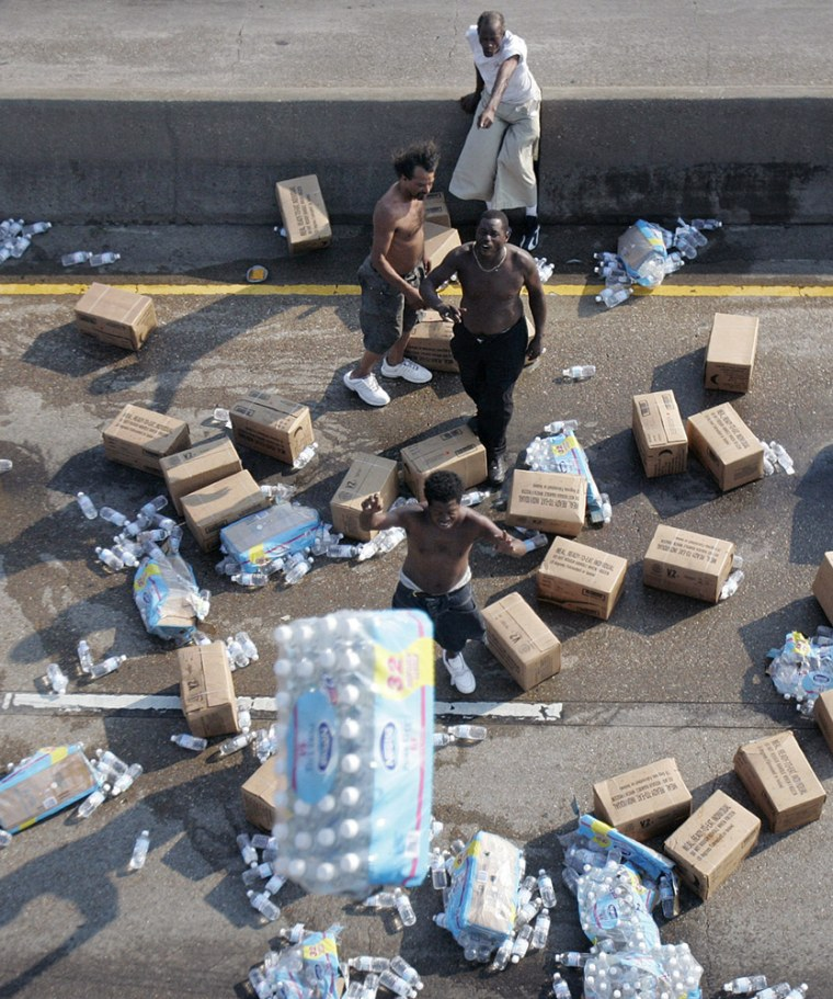 Hurricane Katrina survivors in New Orleans recover water and Meals-Ready-to-Eat dropped by members of Bravo Company 2-4 Aviation, 4th Infantry Division out of Fort Hood, Texas, from a Chinook helicopter, in this Sept. 2, photo.