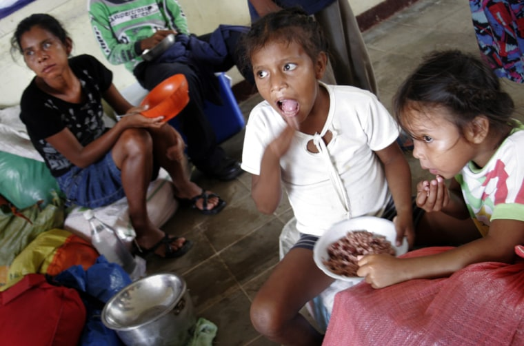 Children eat a rice meal at the shelter in the Ducado de Luxemburgo Normal School, in Puerto Cabezas, 335 miles northeast of Managua, Nicaragua, on Sunday.