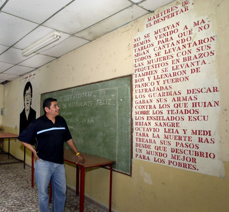 """Julio Cesar Mendez, 42, reads a poem written on a wall at the """"El Despertar"""" Catholic home of retirees in San Salvador, where a priest and four youths were assassinated by the army at the beginning of El Salvador's civil war in January 1979."""
