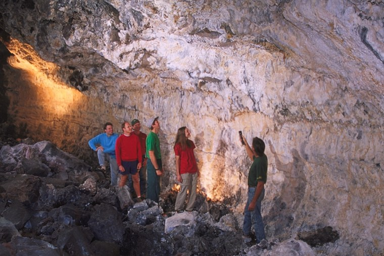 Owner of Kula Kai Cave Ric Elhard, right, leads a group on the walking tour at Kula Kai Cave lighted trail tour in Hawaii.