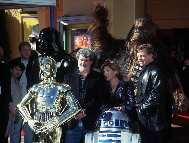 1/18/97 Los Angeles, Ca George Lucas, Mark Hamil, Carrie Fisher, and the characters at the prmiere o