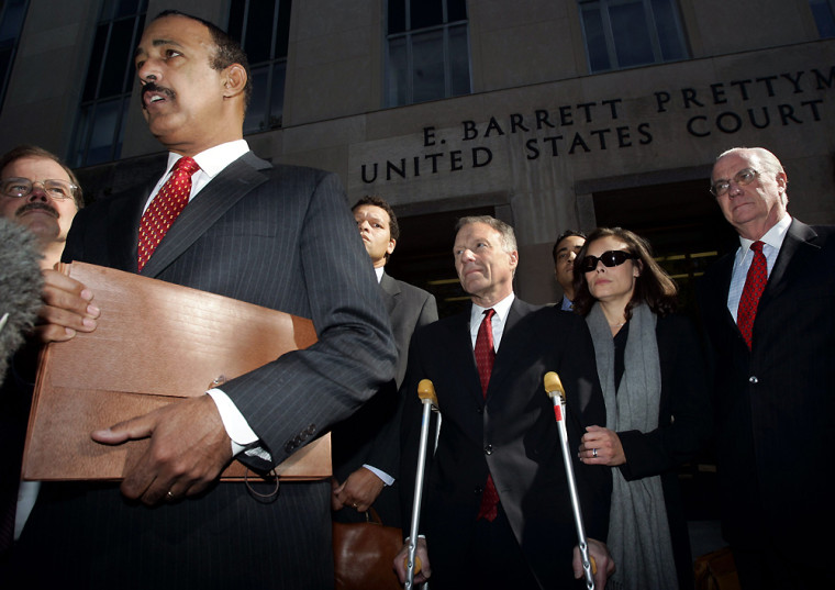 Lewis Libby listens to his lawyer speak outside court in Washington