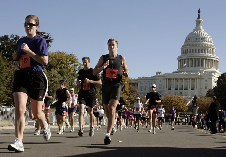 Participants in the annual Marine Corps Marathon run past the Capitol building on Oct. 30 in Washington.