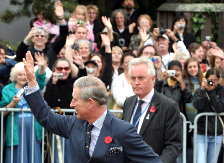 Britains Prince Charles waves to crowd at Martin Luther King Middle School in Berkeley California