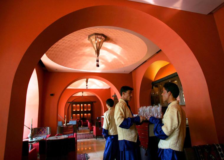 Afghan waiters work in Kabul Serena Hotel in Afghanistan