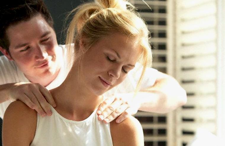 Woman Receiving a Massage of Man