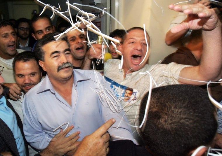 Trade union boss Amir Peretz, 46, celebr