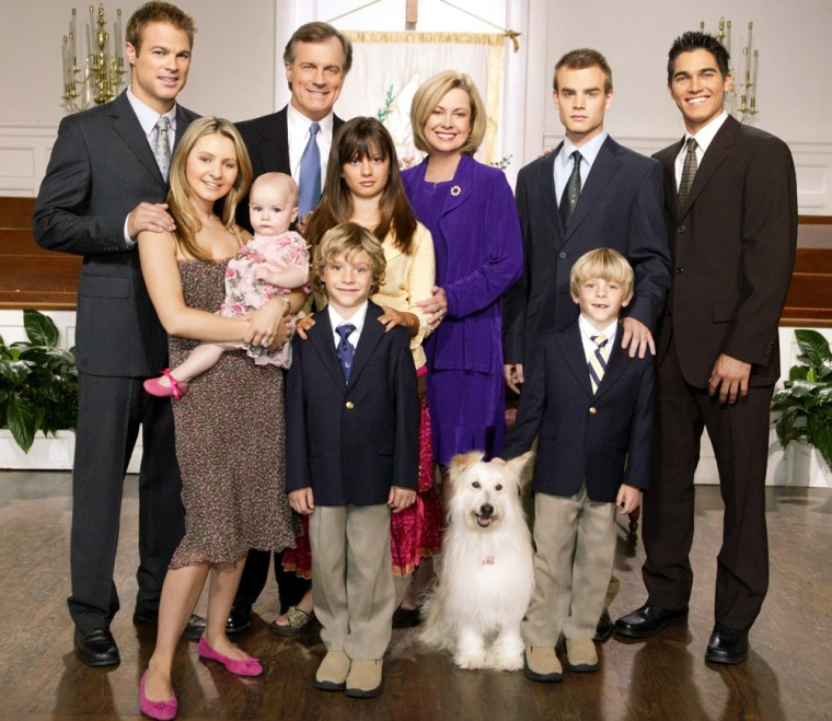 """This undated photo supplied by the WB network shows the fictional Camden family of the \""""7th Heaven\"""" television series. The family is passing into television history, with the network announcing Friday, Nov. 11, 2005, that \""""7th Heaven\"""" will end its run after 10 seasons of growing pains for the Rev. Eric Camden and his brood. They are, back row, left to right: George Stults as Kevin Kinkirk, Stephen Collins as Rev. Eric Camden, Catherine Hicks as Annie Camden, David Gallagher as Simon Camden, Tyler Hoechlin as Martin Brewer; Front row, from left: Beverley Mitchell as Lucy Kinkirk,  Mackenzie Rosman as Ruthie Camden, Happy the Dog as Happy, Lorenzo Brino as David Camden, Nikolas Brino as Sam Camden. (AP Photo/The WB,Paul McCallum)"""