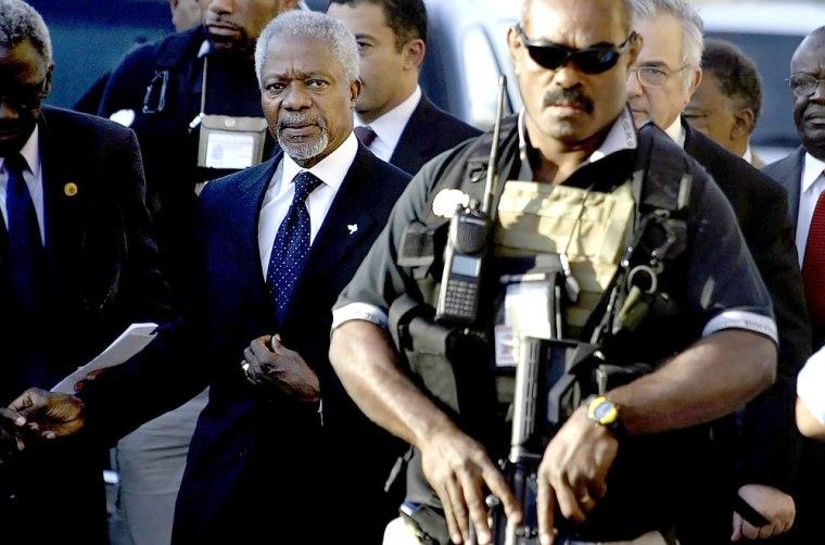 A bodyguard escorts UN Secretary General