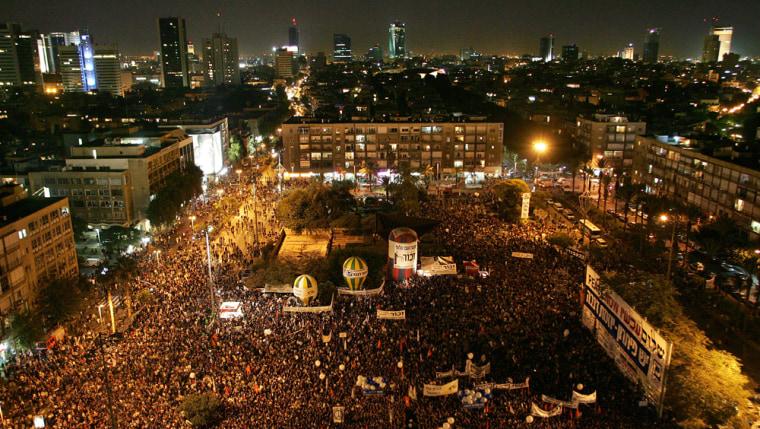 Tens of thousands gather on Saturday at the Tel Aviv squarewhere Israeli Prime Minister Yitzhak Rabin was killed bya Jewish ultra-nationalist on Nov. 4, 1995.