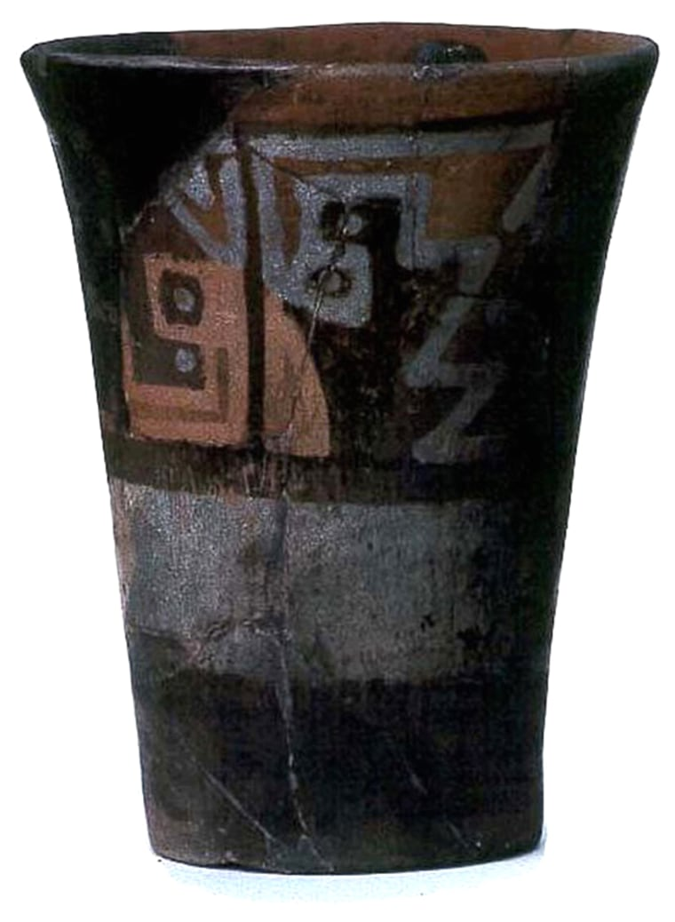 This chicha libation vessel was cast into a brewery as it was being abandoned and burned. The vessel was broken and scorched in the fire, but it was pieced back together by researchers.