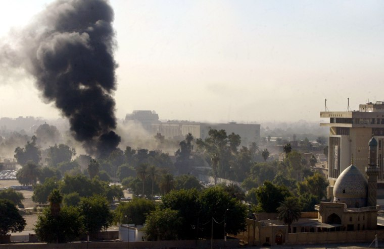 Black smoke billows from the site of an