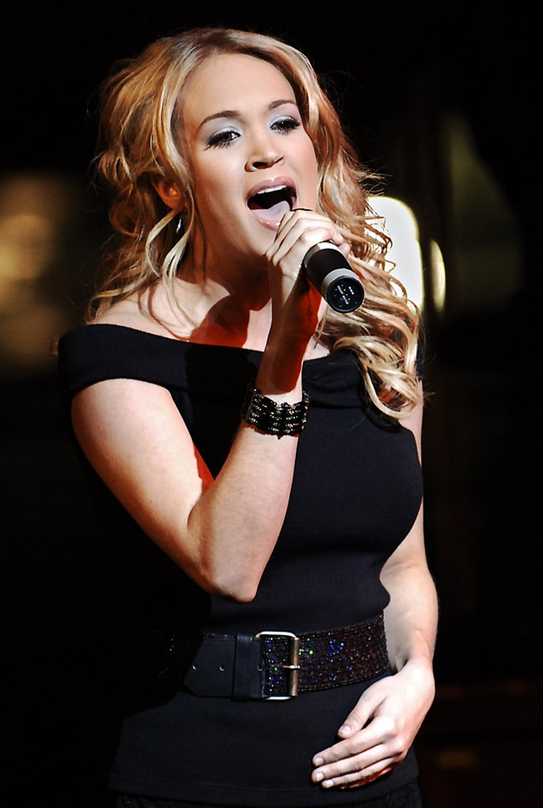 """Singer Carrie Underwood and recent American Idol winner performs at the \"""" Broadway Meets Country\"""" benefit concert to aid the Actors Fund and the American Red Cross at Lincoln Center, Saturday, Nov. 12, 2005, in New York.  (AP Photo/ Louis Lanzano)"""