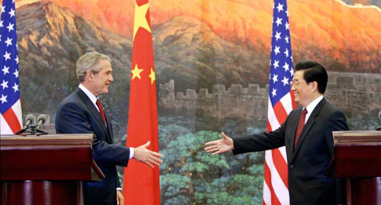 US President Bush and China's President Hu shake hands after their meeting in Beijing