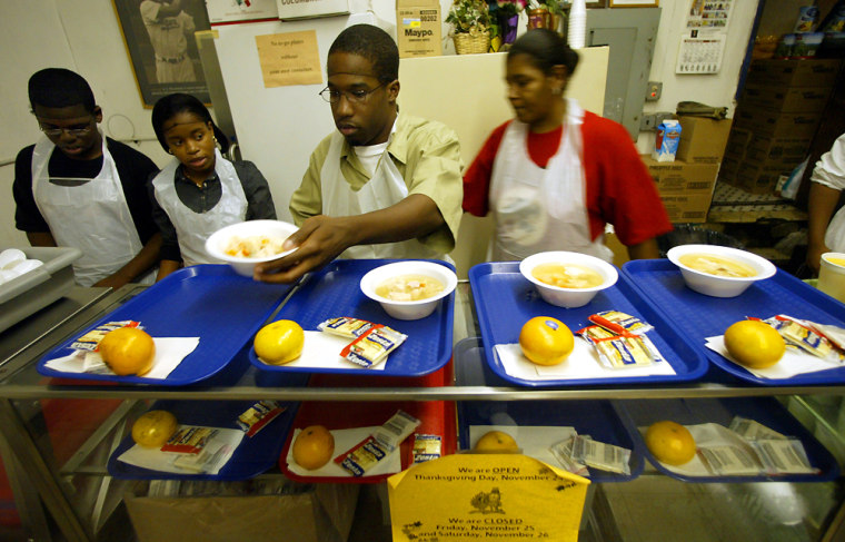 Volunteerswork at asoup kitchen Wednesday in Brooklyn, N.Y. In the weeks after Hurricane Katrina, Americans sent food to the thousands of people displaced by storms in the Gulf, but some charities in cities far from the disaster zones are reporting a decline in donations.