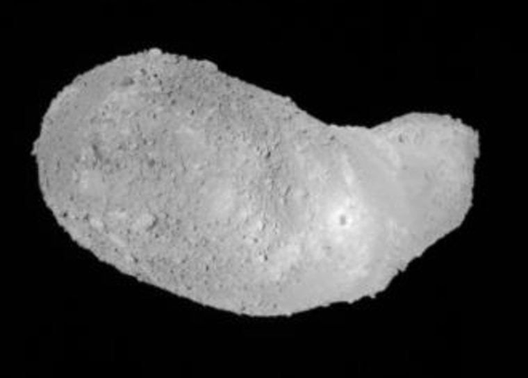 This view of the asteroid Itokawa was captured by Japan's Hayabusa spacecraft onNov.26from a distance of about 1,640 feet (500 meters). The probe's shadow can be seen as a dark mark on the asteroid's surface.