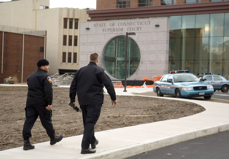 Police sweep the courthouse in Stamford, Conn., on Friday after a bomb threat was called in to the governor's office.