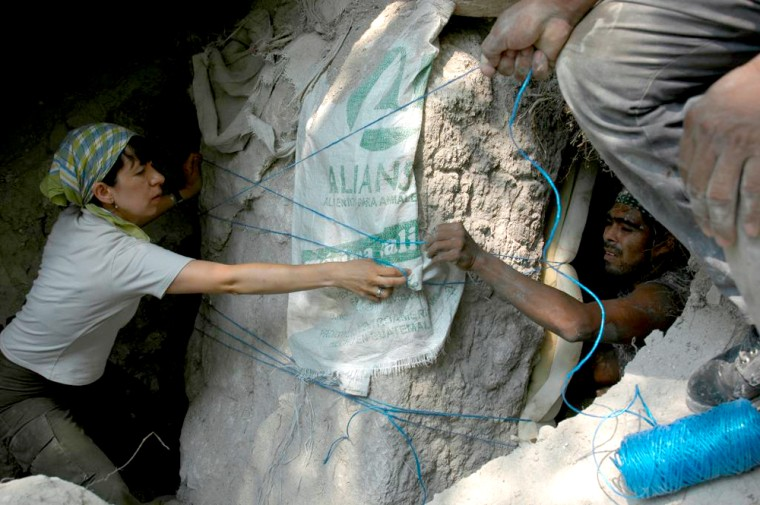 University of Calgary student Alejandra Alonzo helps wrap up a 4th-century stela at Naachtun, a Mayan archaeological site.