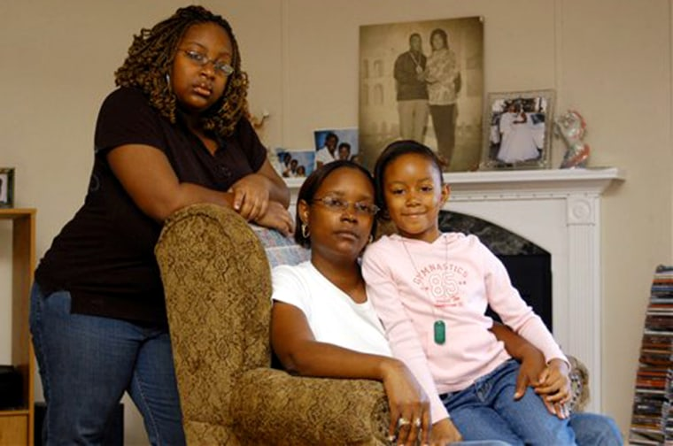 Michelle Thomas, center, and her daughters, A'Shanti Bush and Maia Bush, in their rental house in Abita Springs, La. The family was displaced from New Orleans by Katrina.