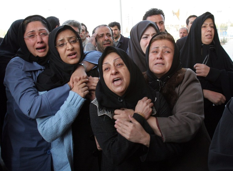 Iranian women react Wednesday to losing loved ones in a plane crash in Tehran.