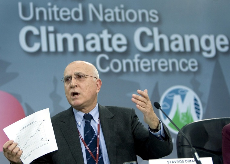 EU Commissioner of Environment shows chart during UN Climate Change Conference in Montreal