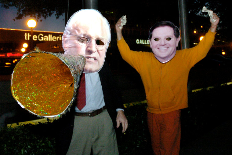 Demonstrators wearing masks of Tom DeLay, right, and Vice President Dick Cheney attend a Monday rally outside a Houston hotel where a Cheney fundraiser was held. Their derision reflects results of a survey that find Americans thinking corruption is endemic to a political system awash in lobbying money and demand for cash.