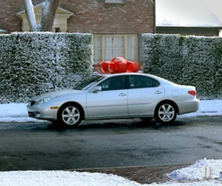 Cars with big red bows feature in the Lexus 'December to Remember' sales promotion. Could there be one outside your house this Christmas?