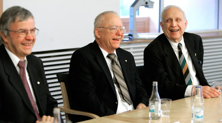 2005 Nobel Physics laureates Theodor W. Haensch of Germany, and John L. Hall and Roy J. Glauber of the United States smile Thursday during a press conference at Stockholm University in Stockholm, Sweden.