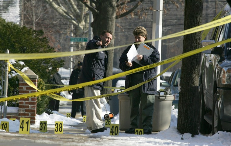 Police investigate the crime scene in the Bronx, N.Y., Saturday, Dec. 10, 2005, where off-duty NYPD officer, Daniel Enchautegui, 28, was shot in the chest before dawn.
