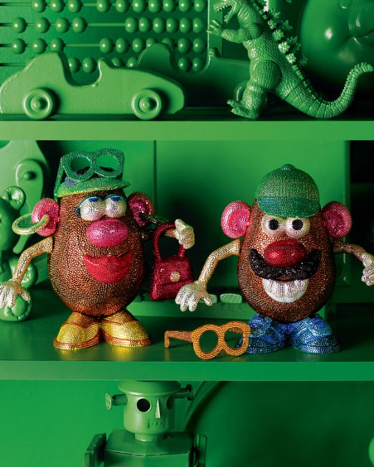 Just 8 1/2 inches tall, 8 inches wide and 5 inches in diameter, these gem-encrusted Mr. & Mrs. Potato Head figures cost $8,000.